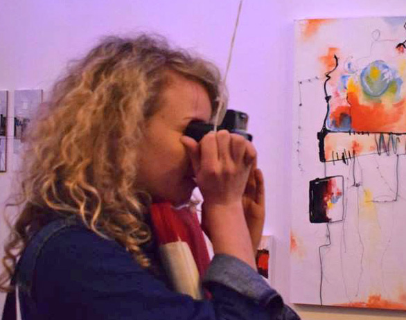 Looking through a Viewer at an art exhibition