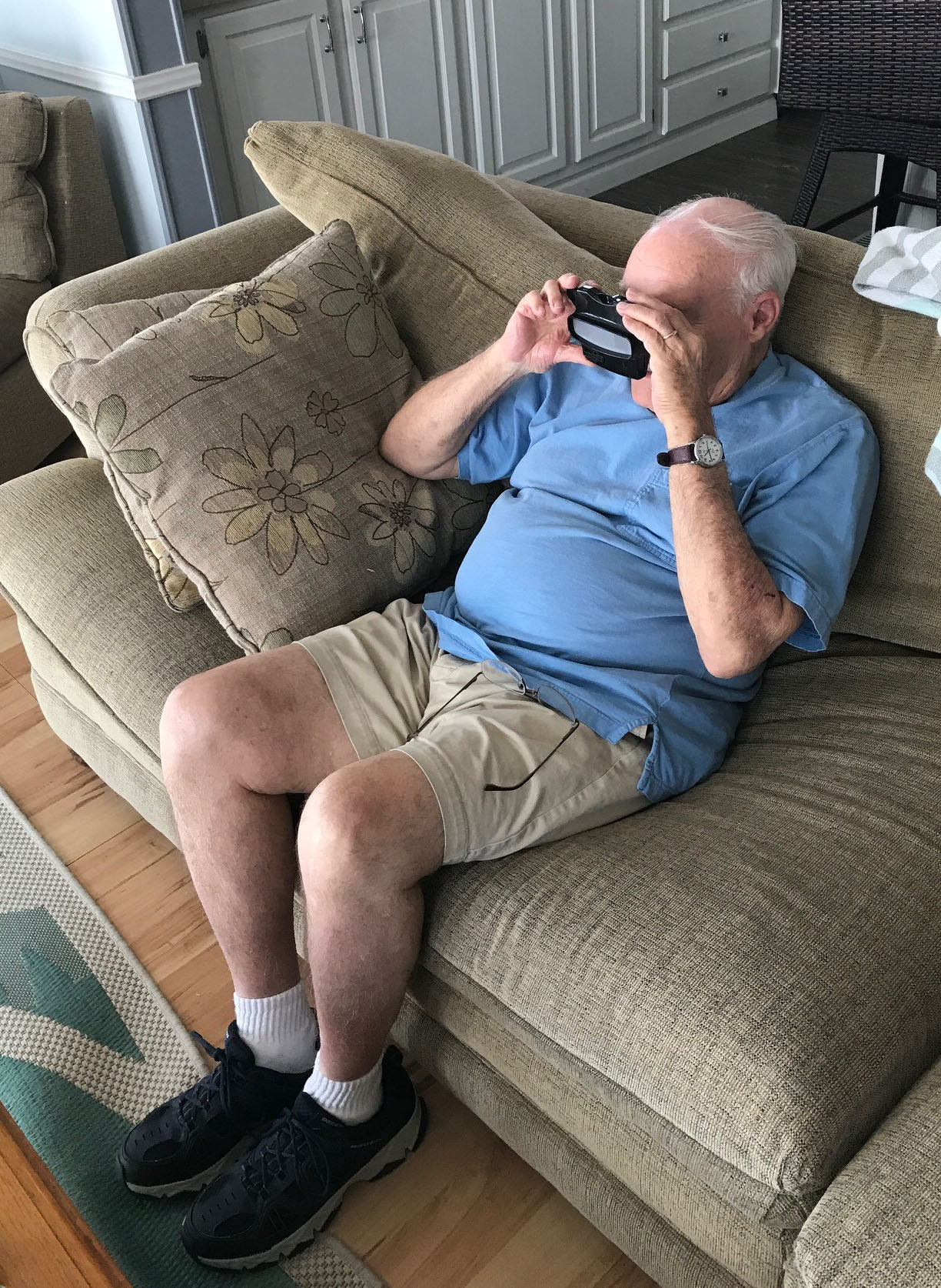 Father-in-law enjoying old photos on a RetroViewer